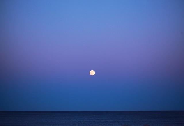 April Supermoon Pink Moon over Atlantic Ocean 2021