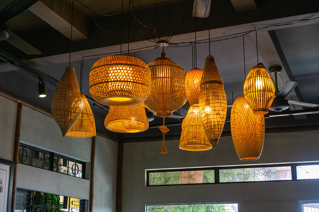 Hanging Bamboo Lamps in different Shapes with Light Bulbs inside a Restaurant and Cafe in Hoi An, Vietnam
