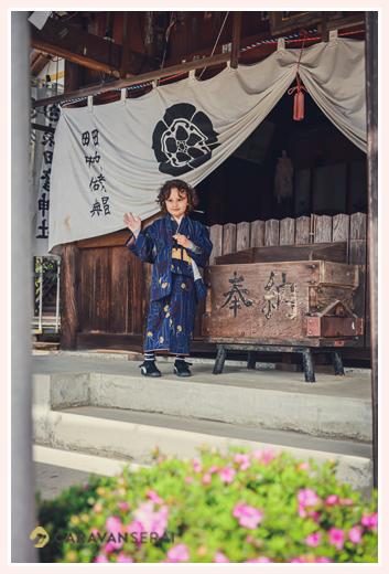 a boy at a shirine