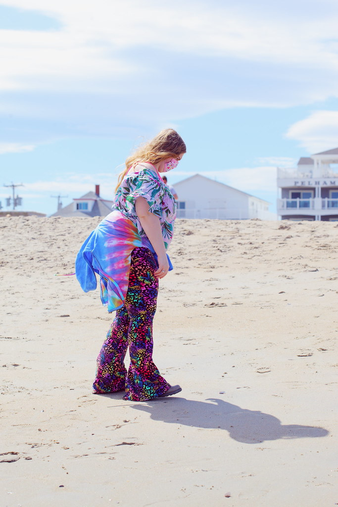 Colorful Woman Walking The Beach in April 2021