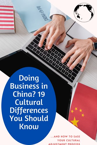 From Doing Business in China? 19 Cultural Differences You Should Know. Hands on a laptop, with USA and China flags and documents on the table.