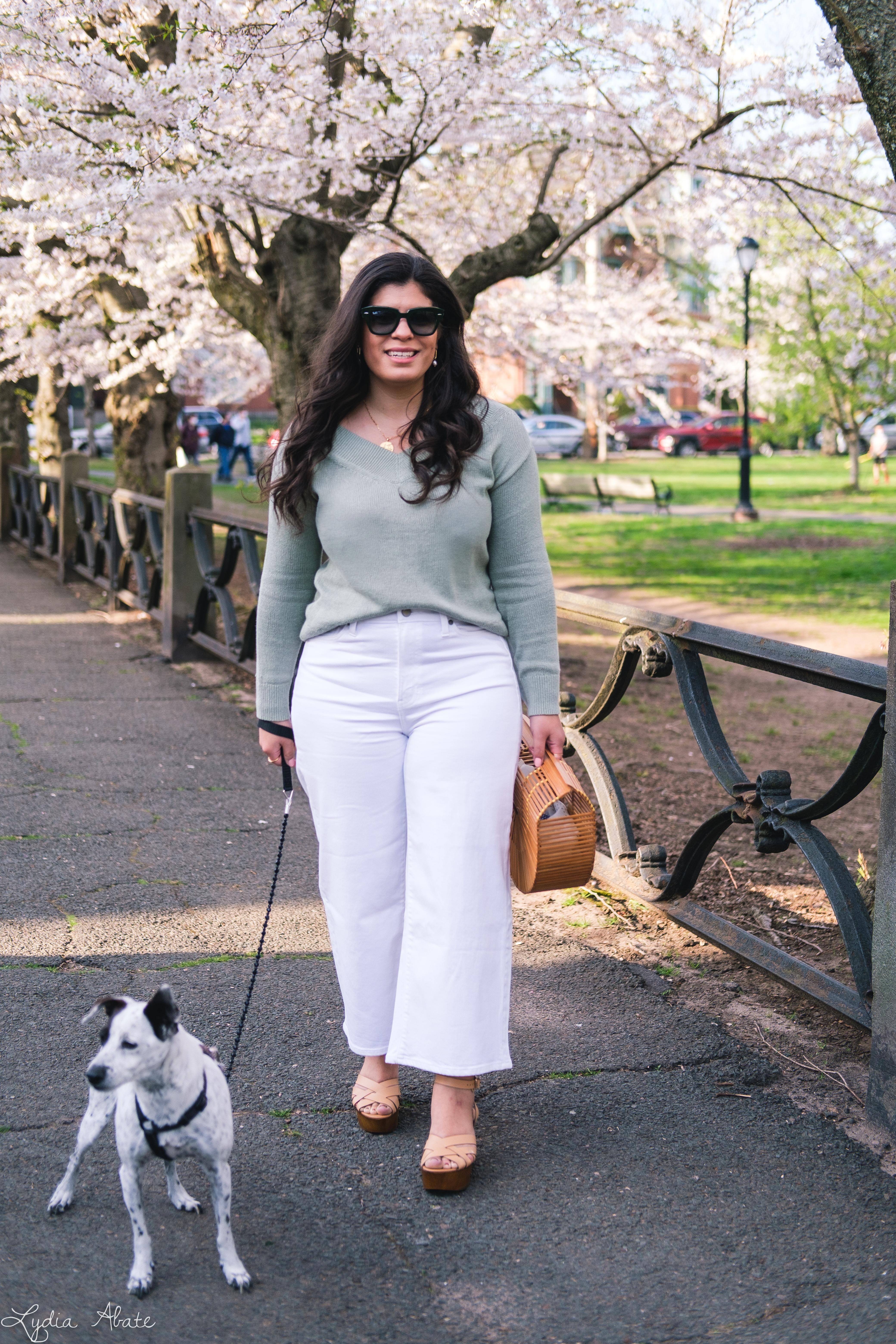 sage green sweater, white wide leg jeans, bamboo bag, dog walking-4.jpg