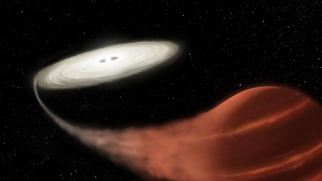 VCSE - Egy törpenóvarendszer illusztrációja. A kép jobb alsó sarkában egy Roche-lebenyét kitöltő kései, hűvös, ezért vörös csillag van, amiról egy gázáramon át az akkréciós diszkbe áramlik át az anyag, ahonnét lassú spirális pályán jut le a korong kzepén lévő fehér törpére. - Forrás: hubblesite.org