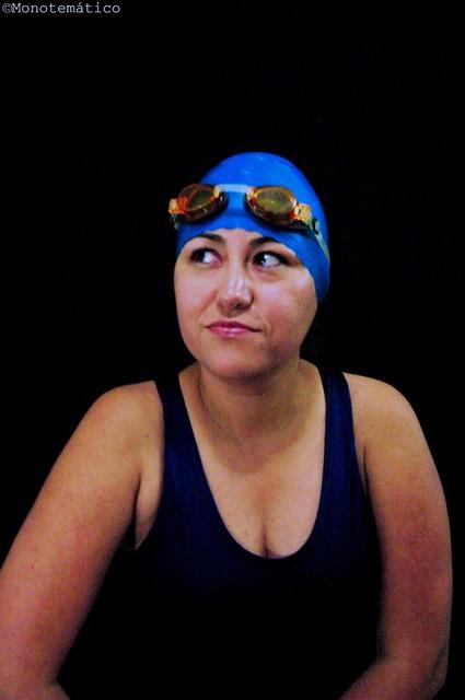 Blue swimmer in black background