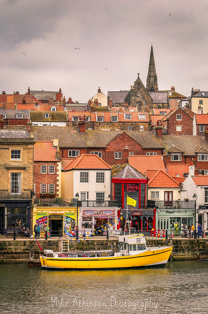 Whitby's Yellow Boats & Cloudy Skies