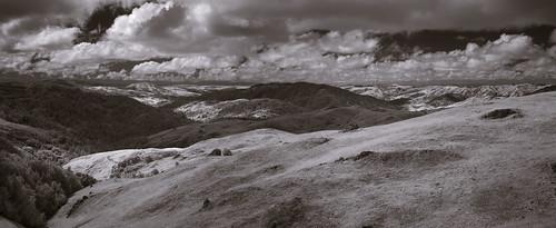 lomaalta lomaaltafireroad landscape sky clouds sunlight shadows hills marincounty california blackandwhite infrared panorama elephantmountain nicasio lucasvalley pacificcoast trees grass rocks horizon