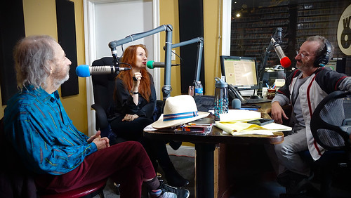 Ron Phillips interviews Harry Shearer and Judith Owen. Photo by Tom Roche.