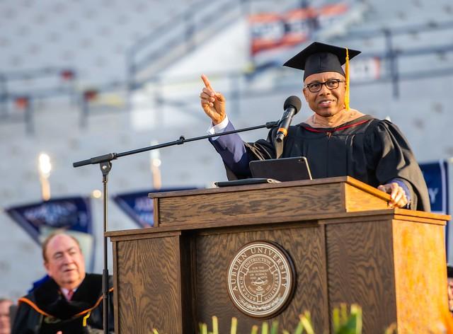 Kenneth Kelly speaks at Auburn graduation as university President Jay Gogue looks on.