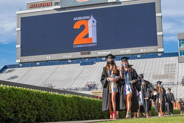 Auburn's spring 2021 graduates walk into Jordan-Hare Stadium.