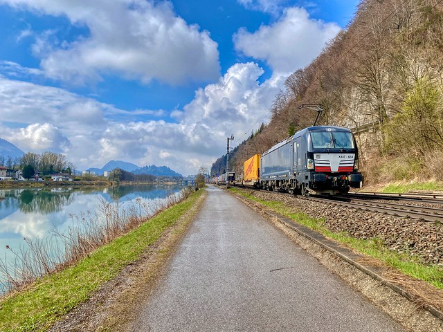 Freight train passing the river Inn between Kufstein and Kiefersfelden in Bavaria, Germany