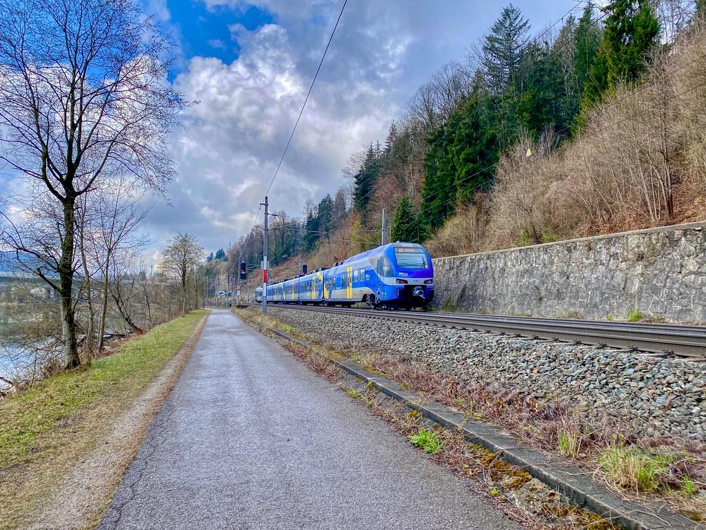 Meridian regional express train passing the river Inn near Kufstein in Tyrol, Austria