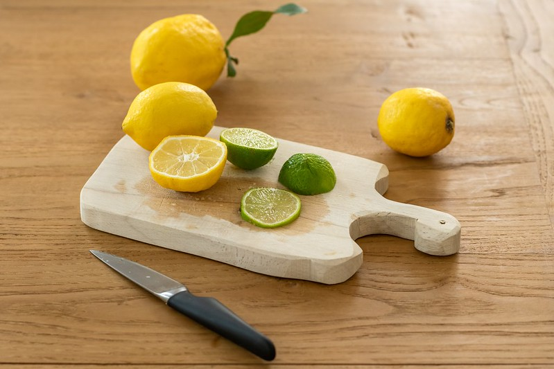 Kitchen Cleaning Tips - Lemons and limes on chopping board