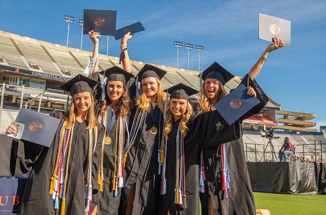 A group of Auburn's spring 2021 graduates at Jordan-Hare Stadium.
