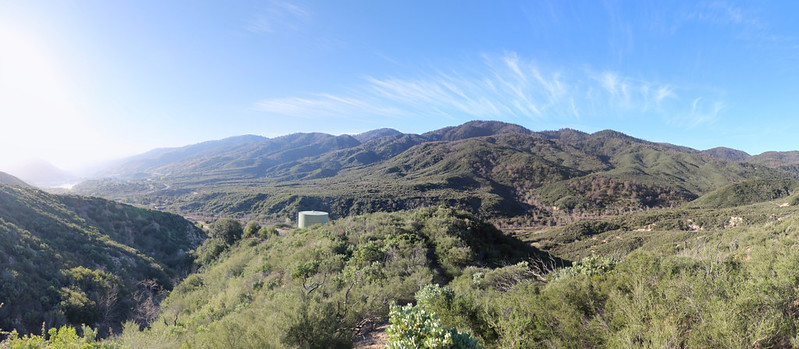 Panorama view from the shortcut road looking south toward the water tank, with Silverwood Lake on the far left