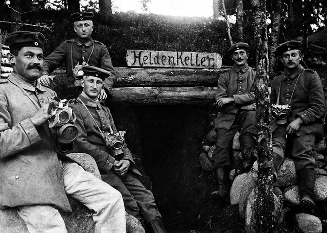 German soldiers sit outside with the M1915 Gummimaske in France during WW1