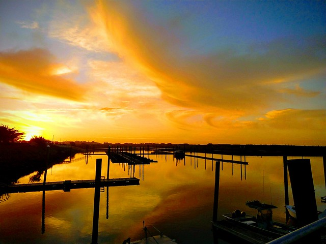 sunset forming over harbor