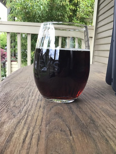 Stormbreaker's Big City Brown ale, in glass on table outdoors