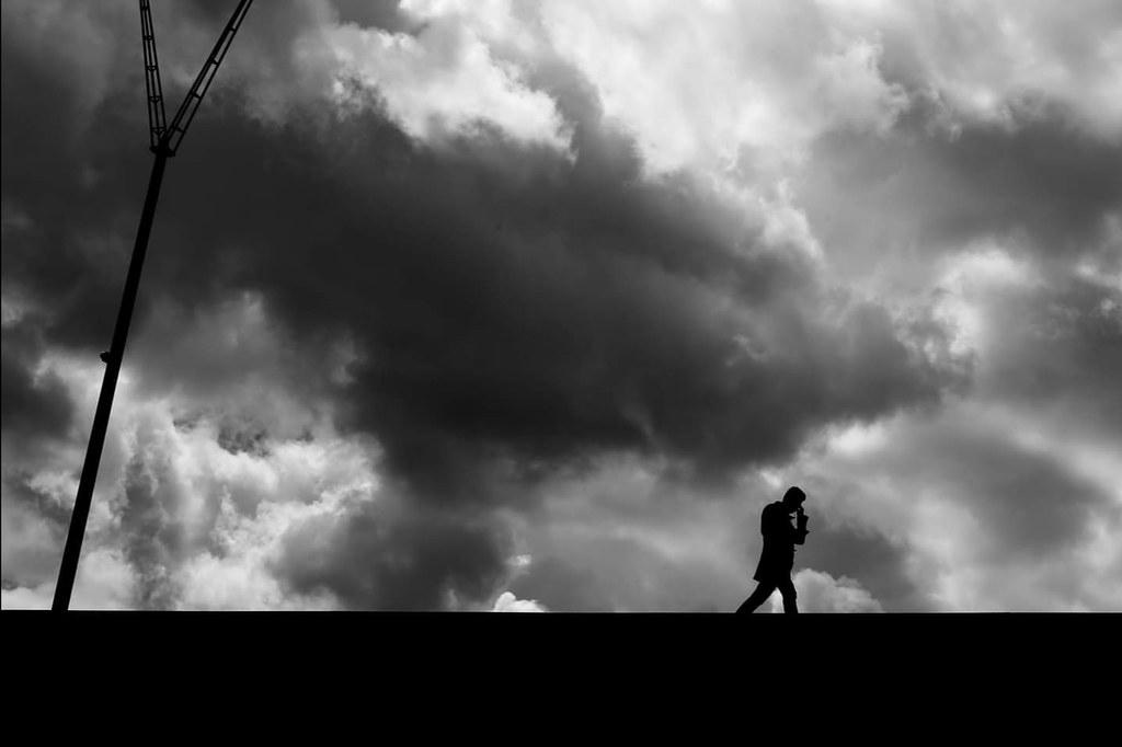 Under the dark clouds