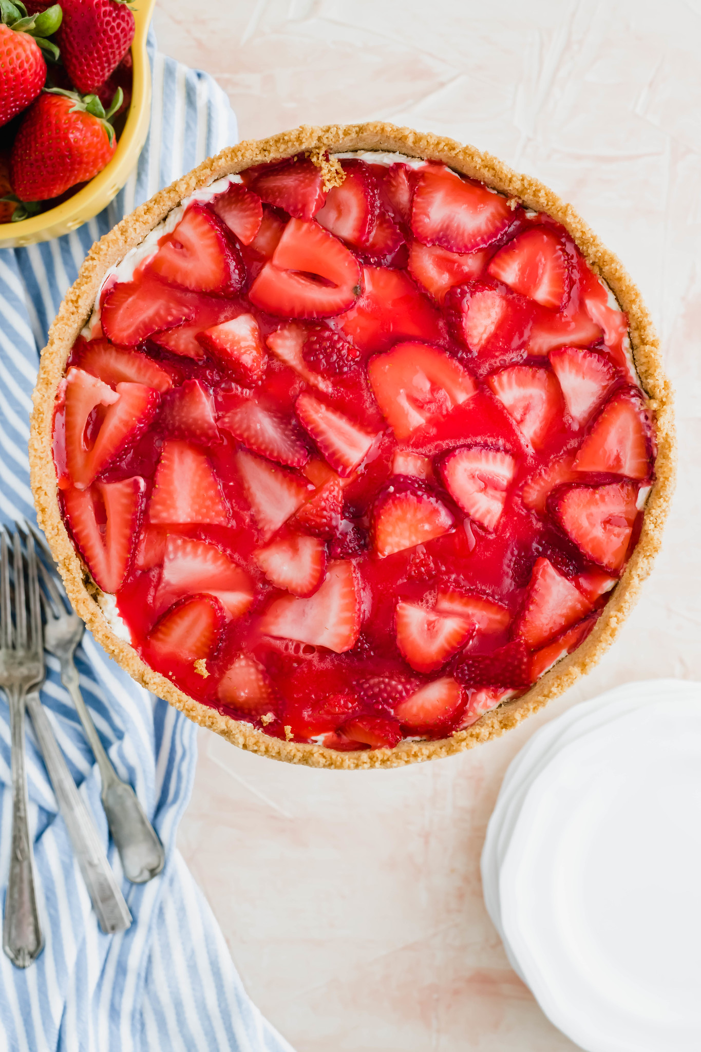 I combined two favorite summer desserts, cheesecake and strawberry pie, to make the most delicious treat, Strawberry Cream Cheese Pie. A fluffy, no-bake cheesecake filling topped with classic strawberry pie filling will have you addicted in no time.