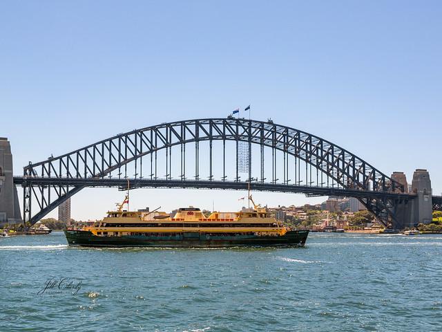 Armchair Traveling - A Ferry Under the Sydney Harbour Bridge