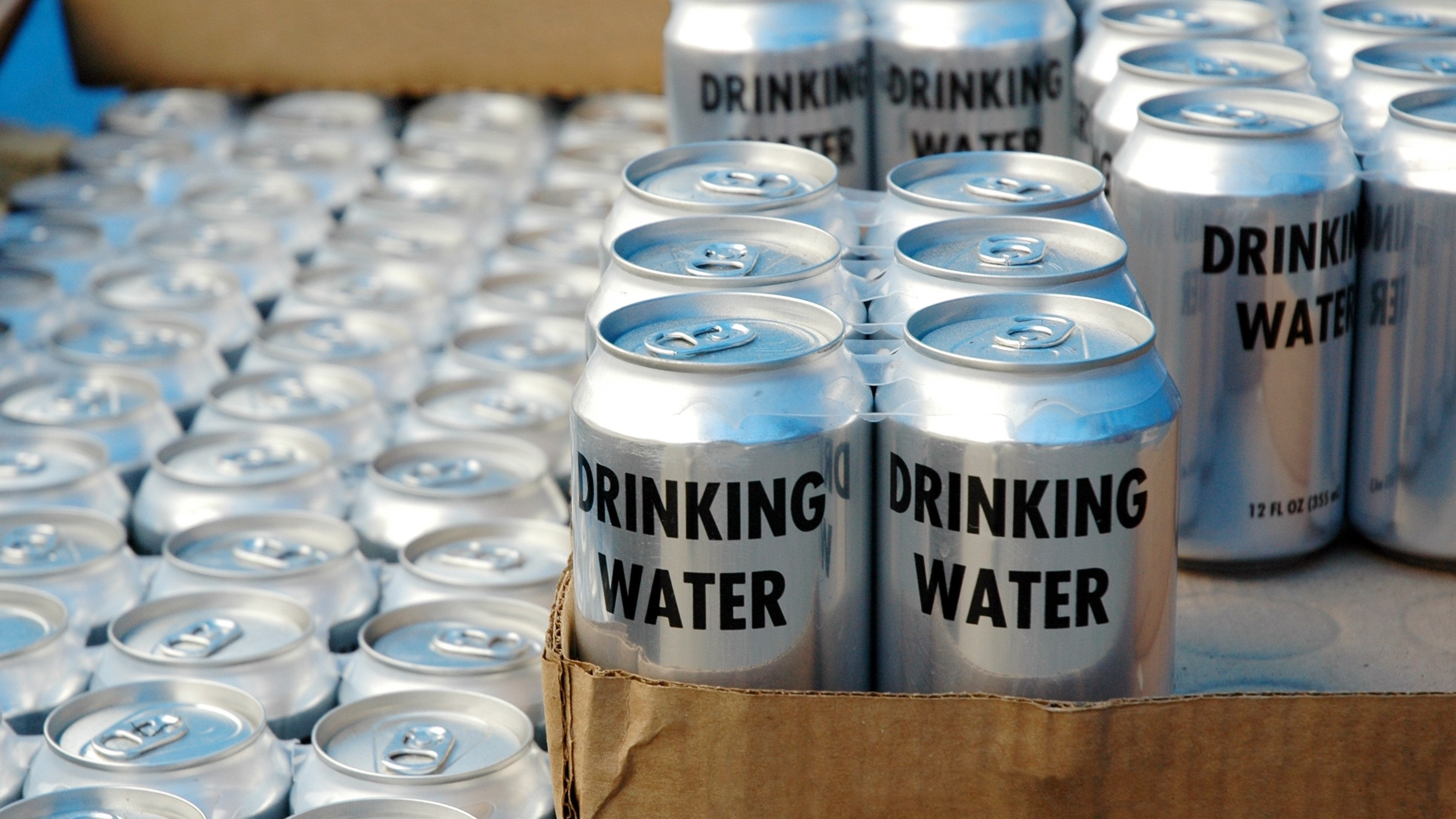 Cans of drinking water in a disaster relief aid programme