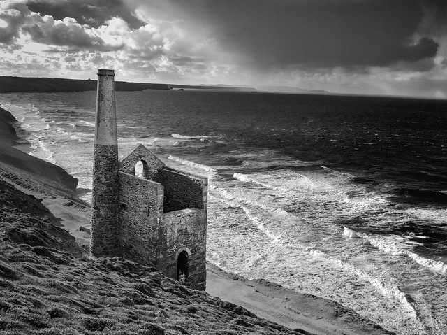 Tin mine with approaching storm