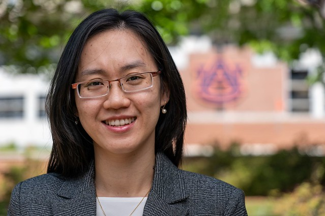 Thi-Thao-Phuong Hoang in front of Jordan-Hare Stadium.