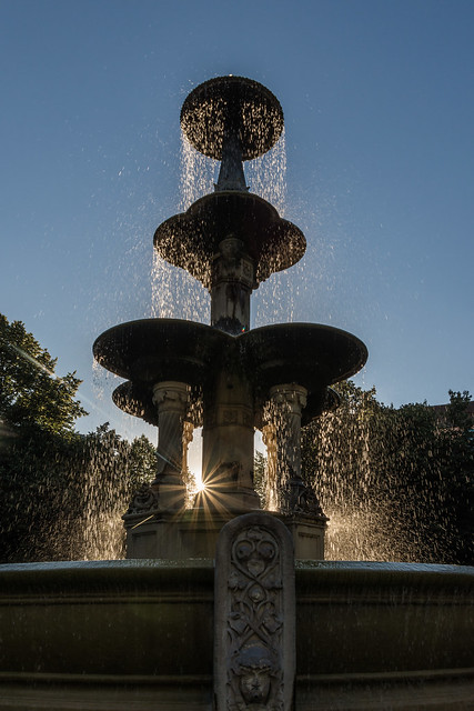 Backlit fountain at sunset