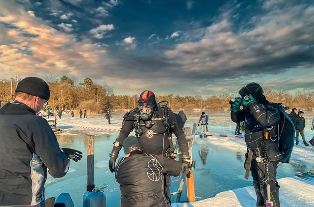 Ice divers at De Rooije Plas, Handel, The Netherlands.