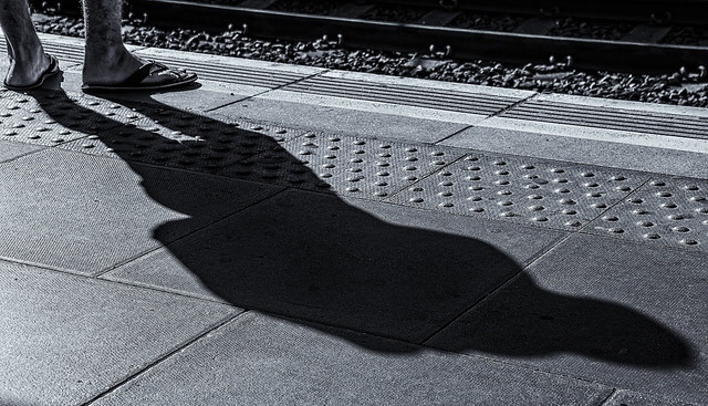 Shadow Of A Man Waiting