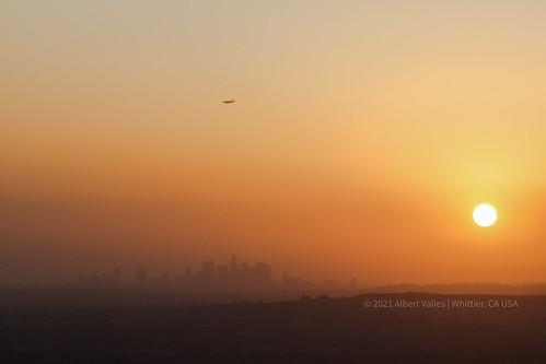 los angeles sunset smog sunlight downtown la whittier california ca cali rose hills memorial park losangeles airplane