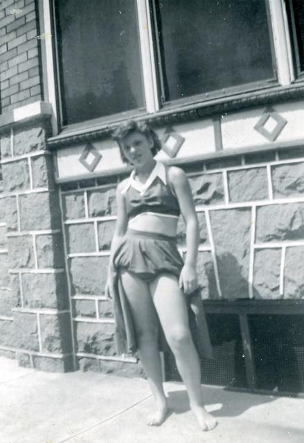Teenage Girl Posing by Building, 1950s