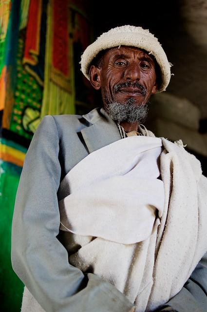 Orthodox priest at Medhane in rock-hewn church - Teka Tesfai, Tigray, Ethiopia - Version 2