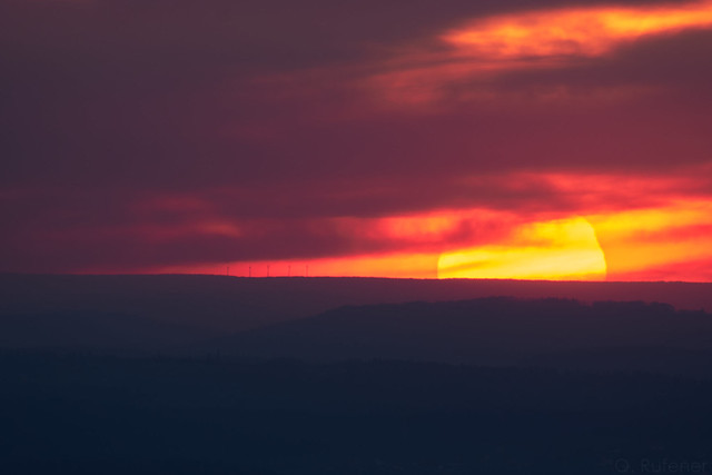 Sunset after a stormy evening. Then, finally, the clouds gave way to a view of the sun at just the right time. A dream.