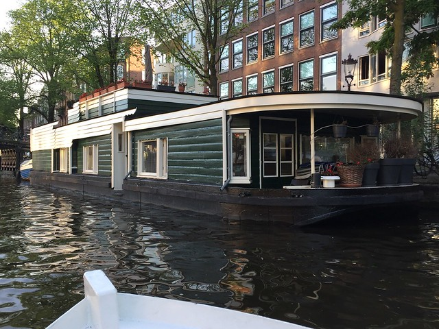 A house boat , woonboot , grachtenpanden , canal homes , ships on the river the Amstel and grachten in Amsterdam , Martin's photographs , North Holland Netherlands , Noord Holland Nederland , Martin's photographs , June 6. 2019