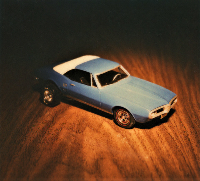 OK, old timers. Remember when Kodak brought out its own version of Polaroid cameras? Their film and cameras were so much better than that of Polaroid. That's what this plastic model of a 1968 Pontiac Firebird was photographed with in my room. Feb 1981.