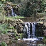 Mini waterfall at Halsam Park in Preston