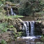Mini waterfall at Halsam Park in Preston