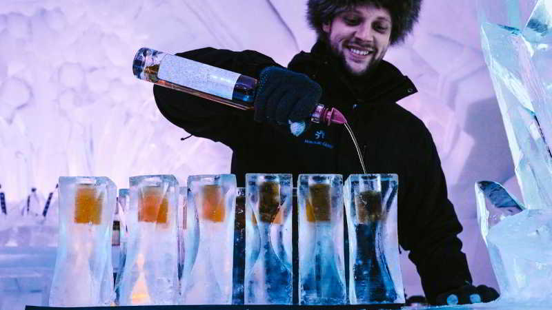 Barman serving in glasses made of ice