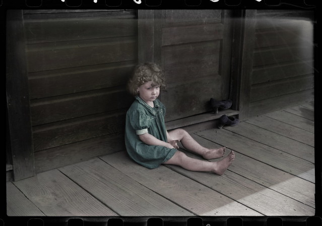Miner's daughter on front porch 1938