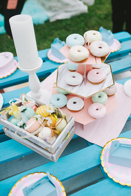 Sugar-coated doughnuts with colourful background.