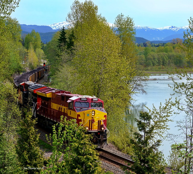 CN (Wisconsin Central) 3069 leads coal & LPG loads west toward Prince Rupert @ mile 3.8, Skeena Sub - 5 May 2021 [© WCK-JST]