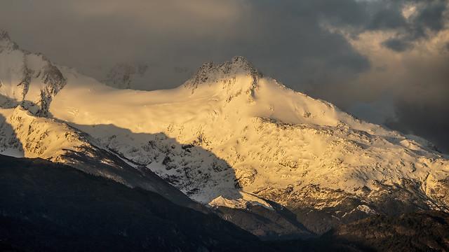 Morning light on snowy peaks