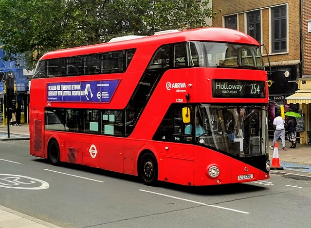Arriva London LT330 is on Whitechapel High St while on route 254 to Holloway Nags Head. Current Prime minister Boris Johnson was involved in designing these buses during his time as London Mayor and takes an interest in buses - LTZ 1330 - 29th August 2020