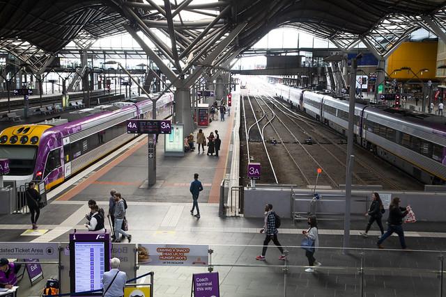 Railway with passengers at platform