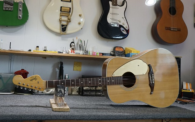 This 1964 Fender King Acoustic was from the Fender reaction to the folk movement in the early '60s. They had so many problems they were taken off the market....later reintroduced as the Kingman with the same issues. This one oddly enough is quite good.