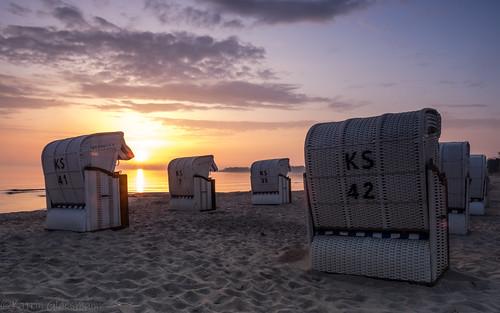 timmendorferstrand ostsee schleswigholstein balticsea bayoflübeck lübeckerbucht sunrise sleswickholsatia derechtenorden therealnorth beach beachchair strandkorb sand clouds