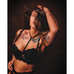 Girl in black lingerie with tattoos