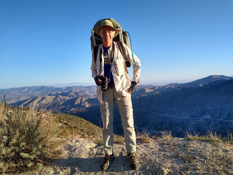 Me, posing on Mount Gleason Road with my vintage 1970s-era backpack, looking north toward Palmdale