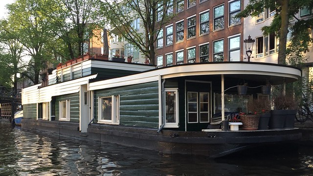 A house boat , woonboot , grachtenpanden , canal homes , ships on the river the Amstel and grachten in Amsterdam , Martin's photographs , North Holland Netherlands , Noord Holland Nederland , cropped photograph , Martin's photographs , June 6. 2019